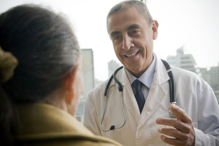 Hispanic doctor talking to patient