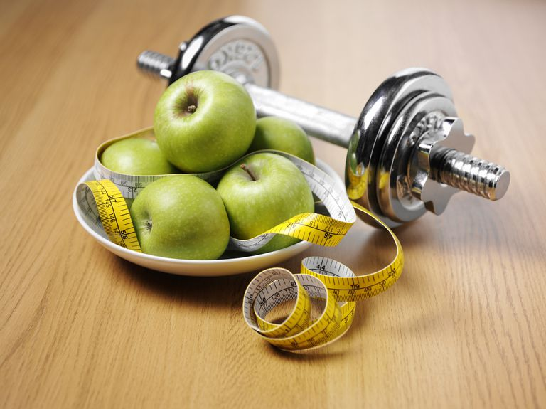 Dumbbells with Apples and Tape Measure