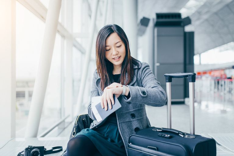 Woman checking her steps on watch at airport