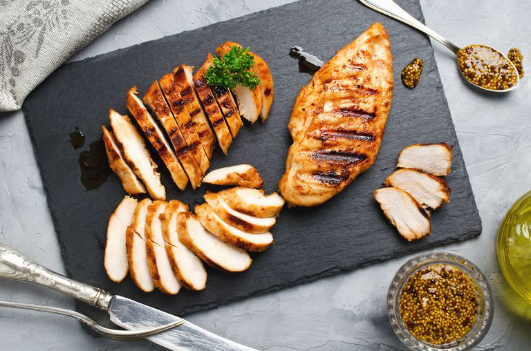 grilled chicken chopped on cutting board