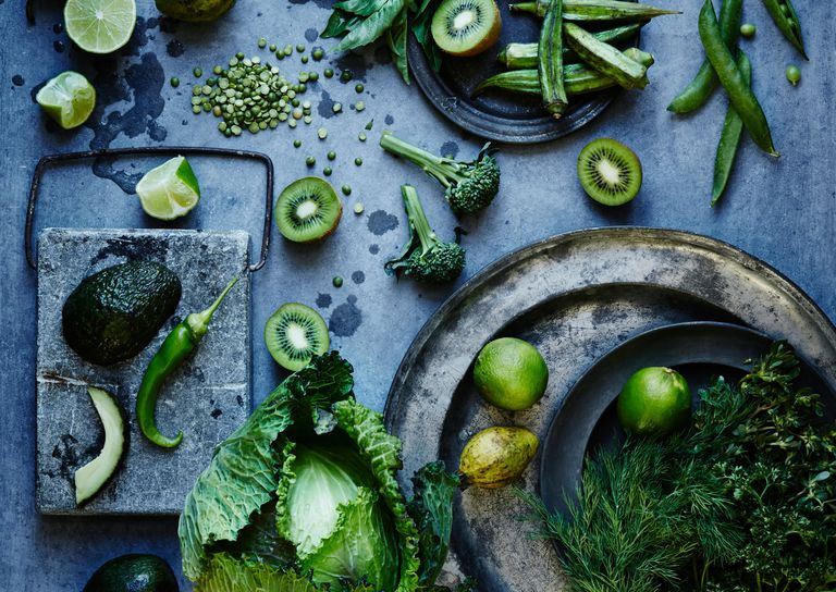 High angle view of green fruits and vegetables on plates