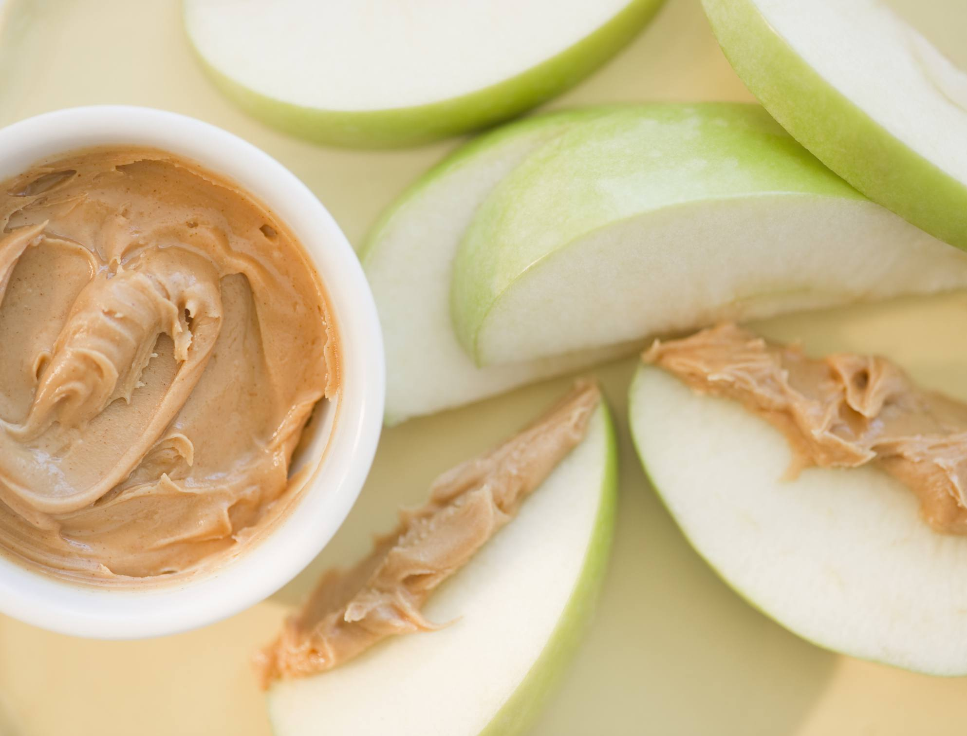 Apples and peanut butter make a good snack for work.