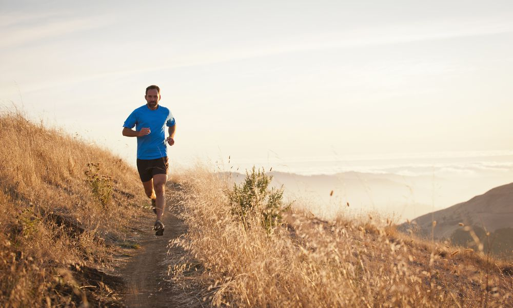 Man running on hillside