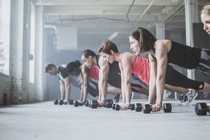 Group Doing Pushups with Dumbbells