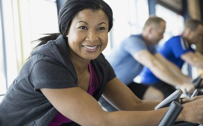Portrait of smiling woman on exercise bike
