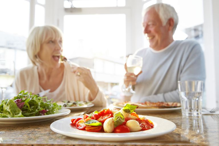 Mature couple eating in a restaurant