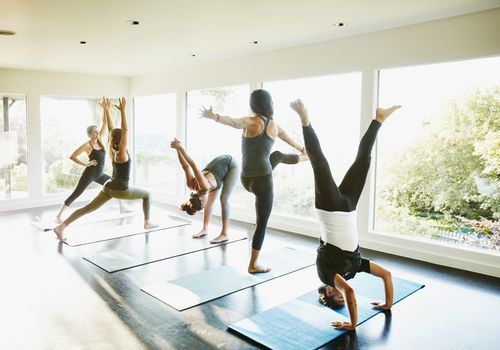 Yoga class in various poses