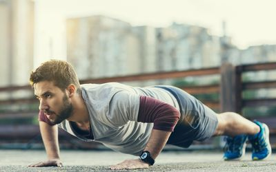 Man doing pushups outside