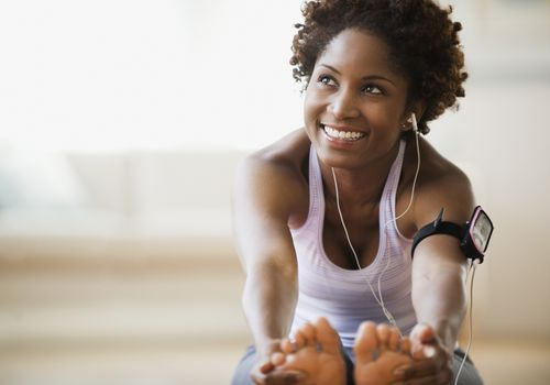 Woman with headphones, stretching