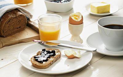 Breakfast with toast, egg, coffee and orange juice