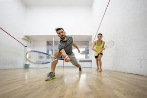 Below view of young man and woman playing squash