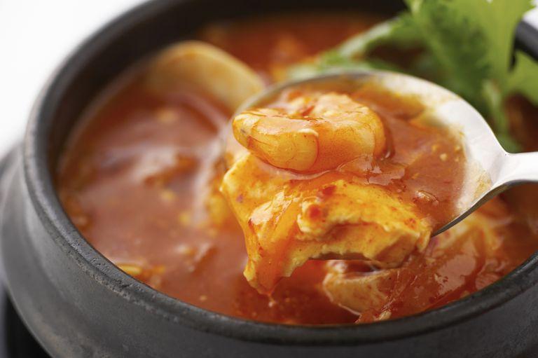 Korean stew with shrimp on spoon