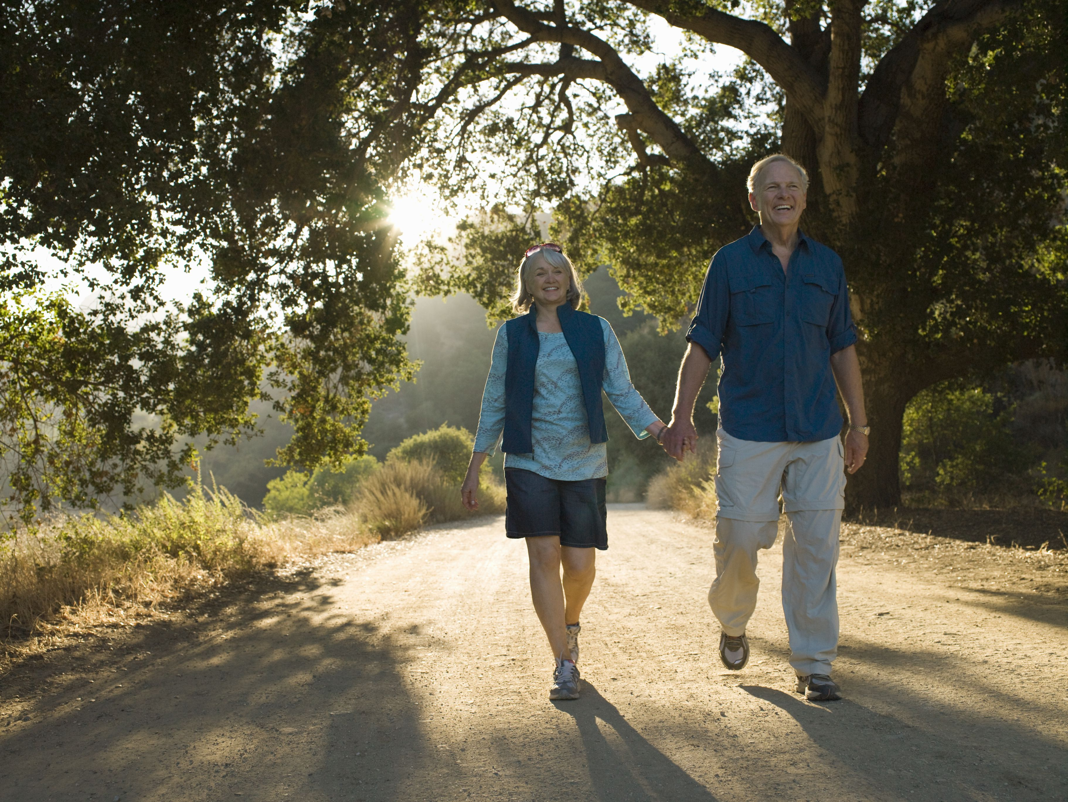 Mature couple walking on natural path