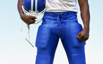 closeup of the legs and hips of a football player in uniform